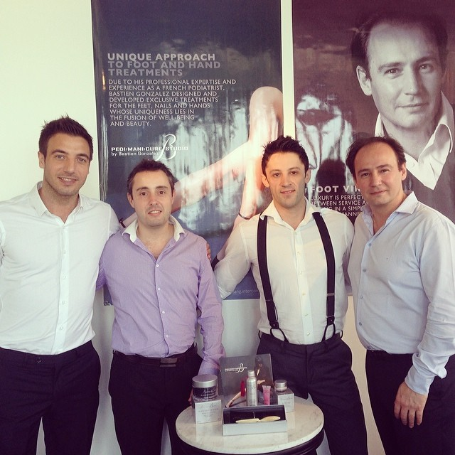 With the man of the hour, Bastien Gonzalez (far right) and his team of hunky podiatrists