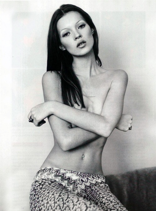 Kate Moss topless and her even more scanty eyebrows.